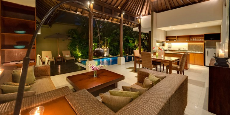 LAK-Solo-Living-area-view-to-pool-at-night