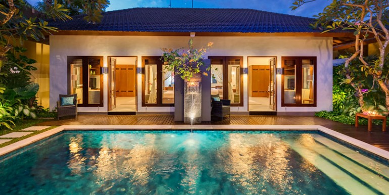 LAK-Pool-view-to-bedrooms-at-night